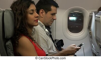 Board Airline Passengers On Airplane