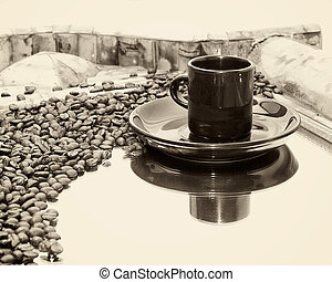 sepia coffee cup and beans reflected on mirror - a coffee...