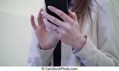 Close up of hands of pretty lady holding the phone.