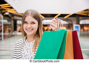 Shopping makes people happy - A photo of young woman...