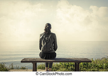 Lonely girl sitting on the bench. - lonely girl sitting on...