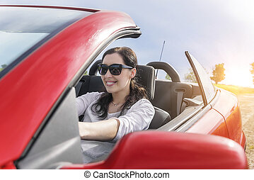 Woman in car. - Happy woman driving a car on a country road...