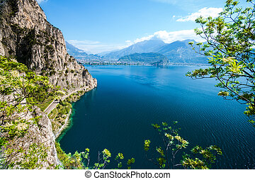 Panorama of the gorgeous Lake Garda surrounded by mountains...