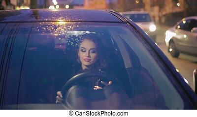 Elegant lady sitting in the car and using phone.