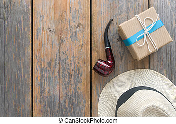 Fathers day gift box with over a wooden background with...