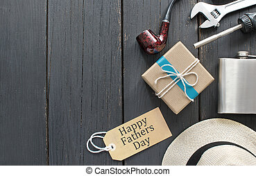 Fathers day gift box tied in blue ribbon over a wooden...