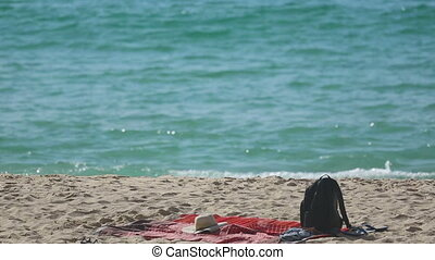 Backpack on the sand beach - Travel Backpack on Summer Sea...