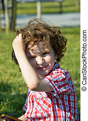 Cute blond hair boy - Cute blond haired child playing on the...