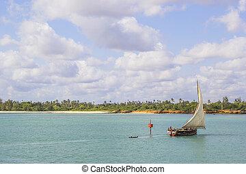 Ship traveling along the coast of Zanzibar - ZANZIBAR,...