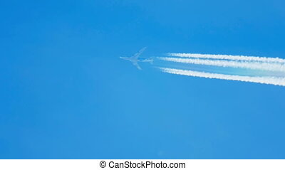 Airplane flying high - Contrails in the blue sky. Boeing 737...