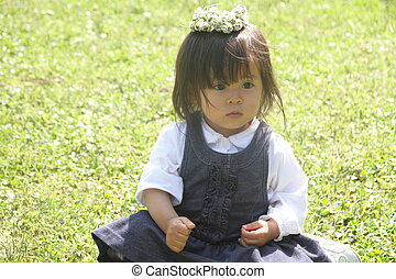 Japanese girl with a chaplet 1 year old