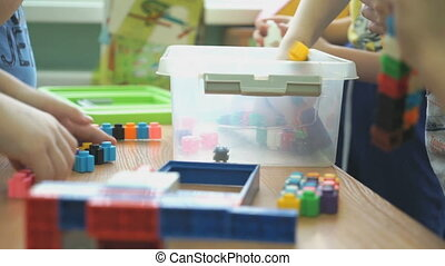 Children play intellectual games at a kindergarten -...