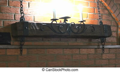 Brick wall with lamps, moose antlers, two guns - Red brick...