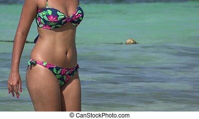 Woman Wearing Bikini In Ocean