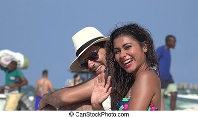 Young Couple Waving On Vacation