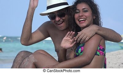 Happy People Waving At Beach