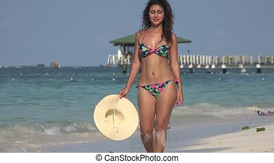 Woman Walking On Beach Wearing Bikini
