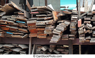 Wood Pile Stack of old wooden bars Stacked wood pine timber...
