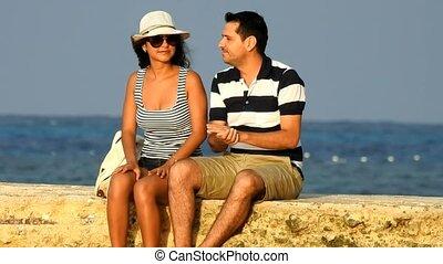 Tourist Couple Relaxing Near Ocean
