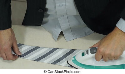 Businessman Getting Ready Irons Tie