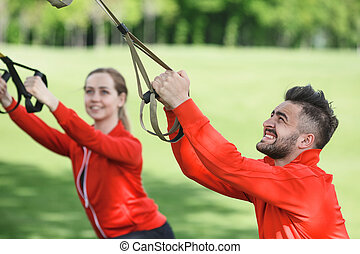 Sport man and woman training in park - Portrait of sport man...