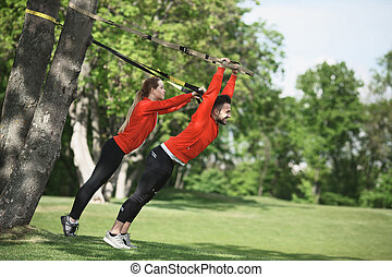 Sport man and woman training in park - Sport man and woman...