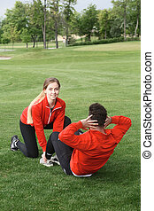 Sport man and woman training in park - Handsome sport man...