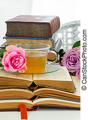 Cup of tea with books - Cup of tea in glass cup with old...