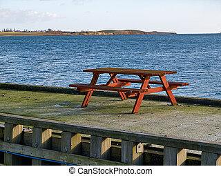 Table made of wood by the sea