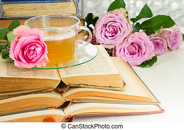 Cup of tea with books - Cup of tea in glass cup with open...