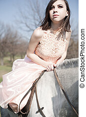 Attractive woman is sitting on the horse - Attractive...