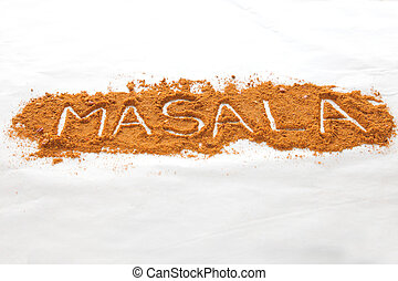 Masala text written in font of spices in perspective