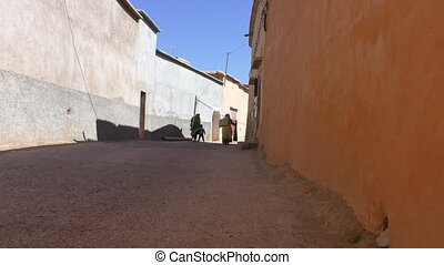 Moroccan village.Two women and kid - Two local women in...