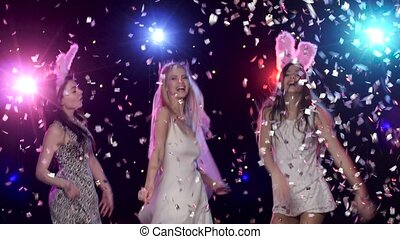 Fun girls at bachelorette party dancing and kiss the bride -...
