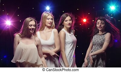 Girls are dancing making hands the similar gestures -...
