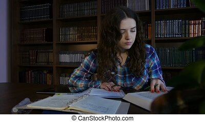 A girl student preparing for exams in the library. 4K