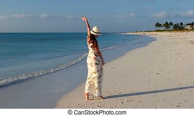 Young beautiful woman enjoying beach tropical vacation