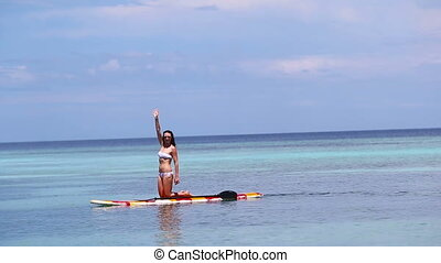 Attractive Young Woman Stand Up Paddle Surfing, Beautiful Tropical Ocean