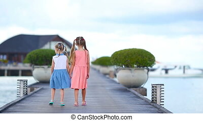 Adorable little girls during summer vacation in the evening