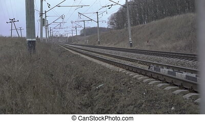 Railway track, isolators, grey grass in the Ukrainian...