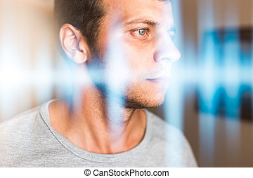 Multiexposure photo of a man and music waves. Hearing,...