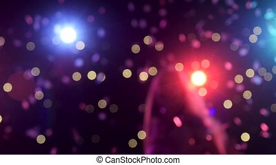 Out of focus background with blurry disco lights dancing girl