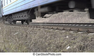 Close up railway, train moving on railway track in the field, bottom of train