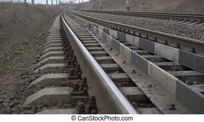 Close up railway track in the field. Slowly
