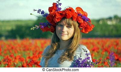 beauty woman in poppy field