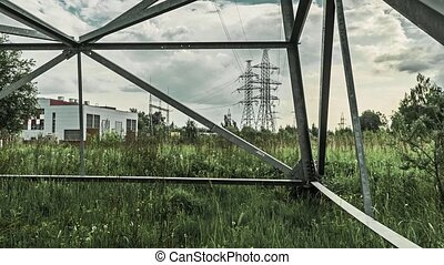 Powerline pylons and electric station 4K cloudy day time...