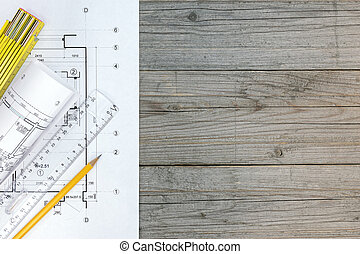 floor plan, ruler and pencil on wooden table