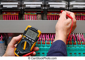 Circuit testimg - Technician testing a control panel wiht...