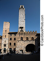 San Gimignano in Tuscany, Italy - Old square in San...