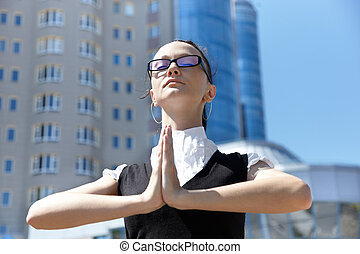 Business meditation - corporate concept with young woman,...